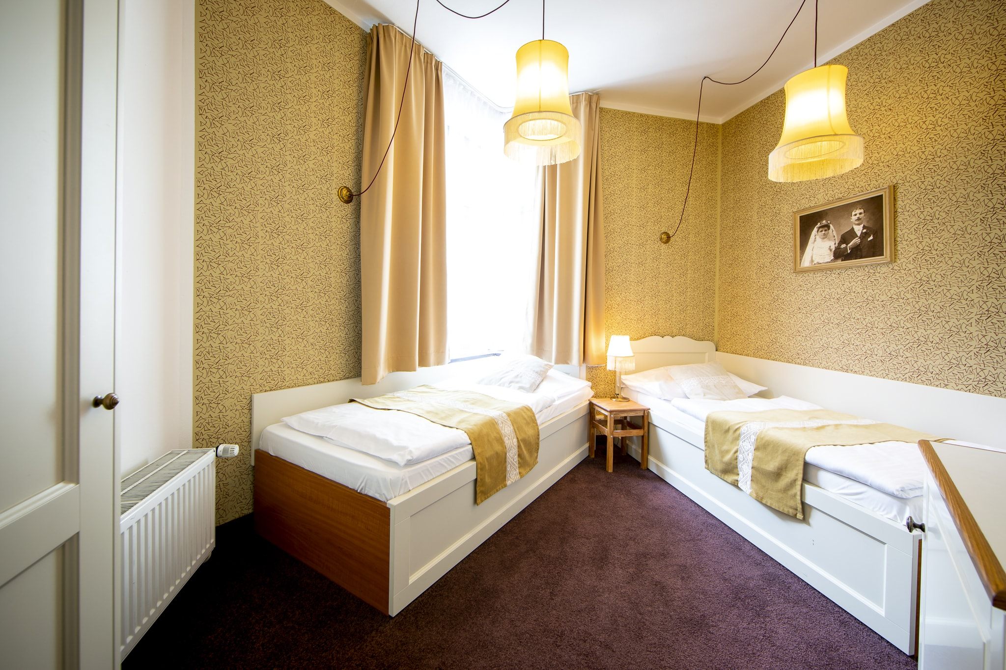 Amadeus Hotel bedroom with two single beds